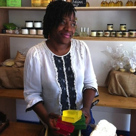 woman making eco-soaps in her shop