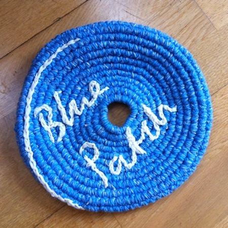 Frisbee in bright blue wool on the floor, made in lambeth