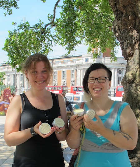 tow women smiling with their products, in Brixton, outside the Ritzy