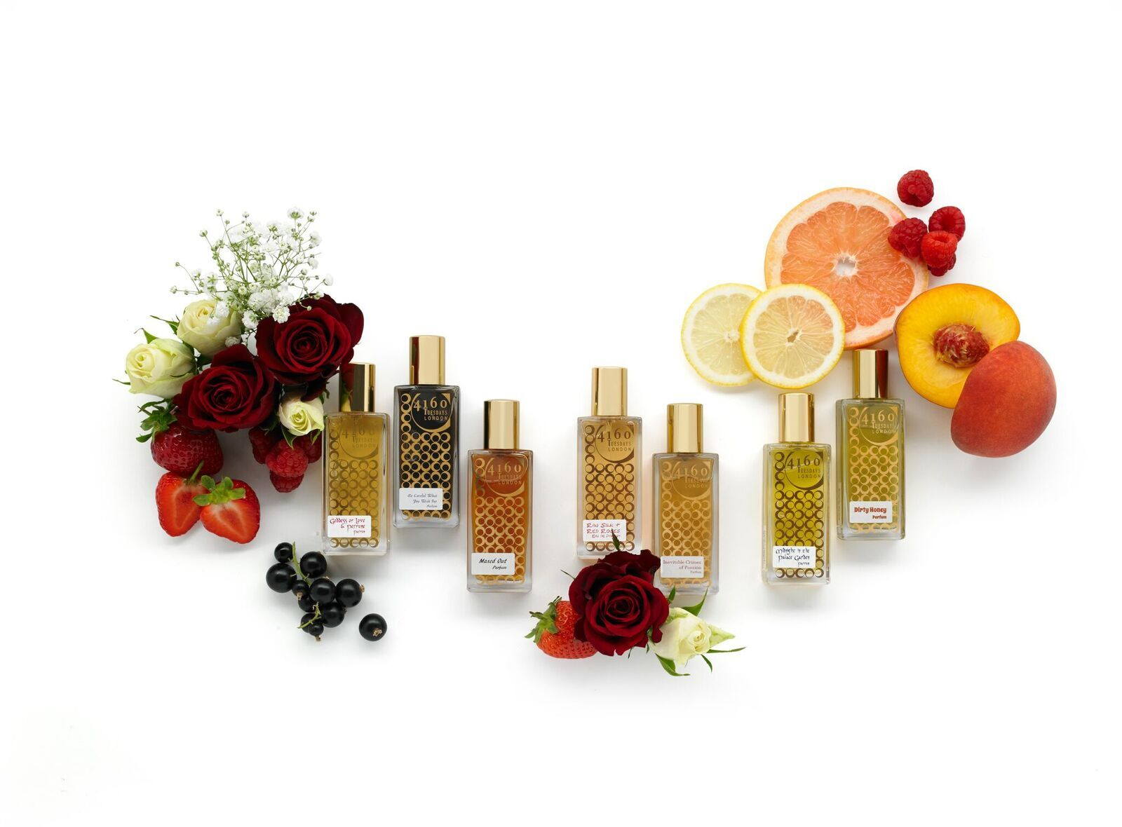 flowers and fruits with a range of perfume bottles