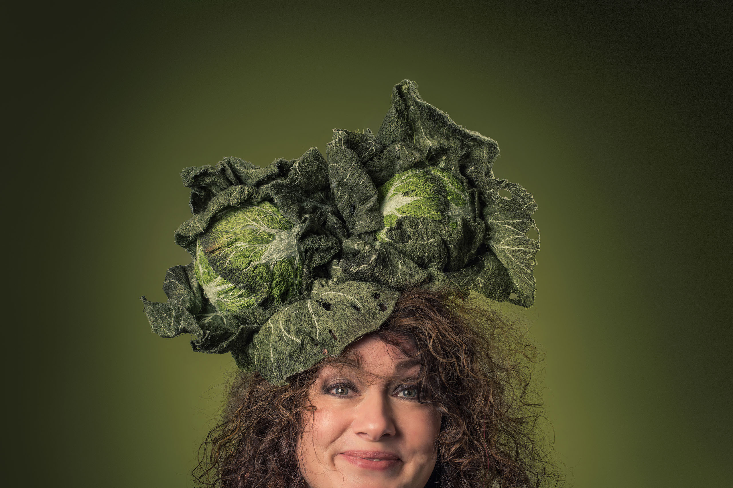 woman with a fabric cabbage on her head