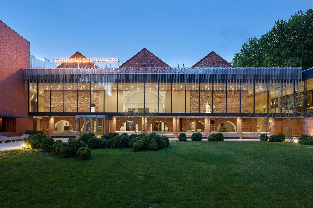 the Whitworth museum contemporary glass extension and gardens, seen at dusk from outside. This is where Blue Patch has a pop up in 2019