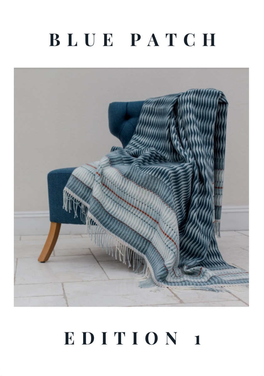 Catalogue cover showing a chair with a wavy blue blanket thrown over it and the words Blue Patch