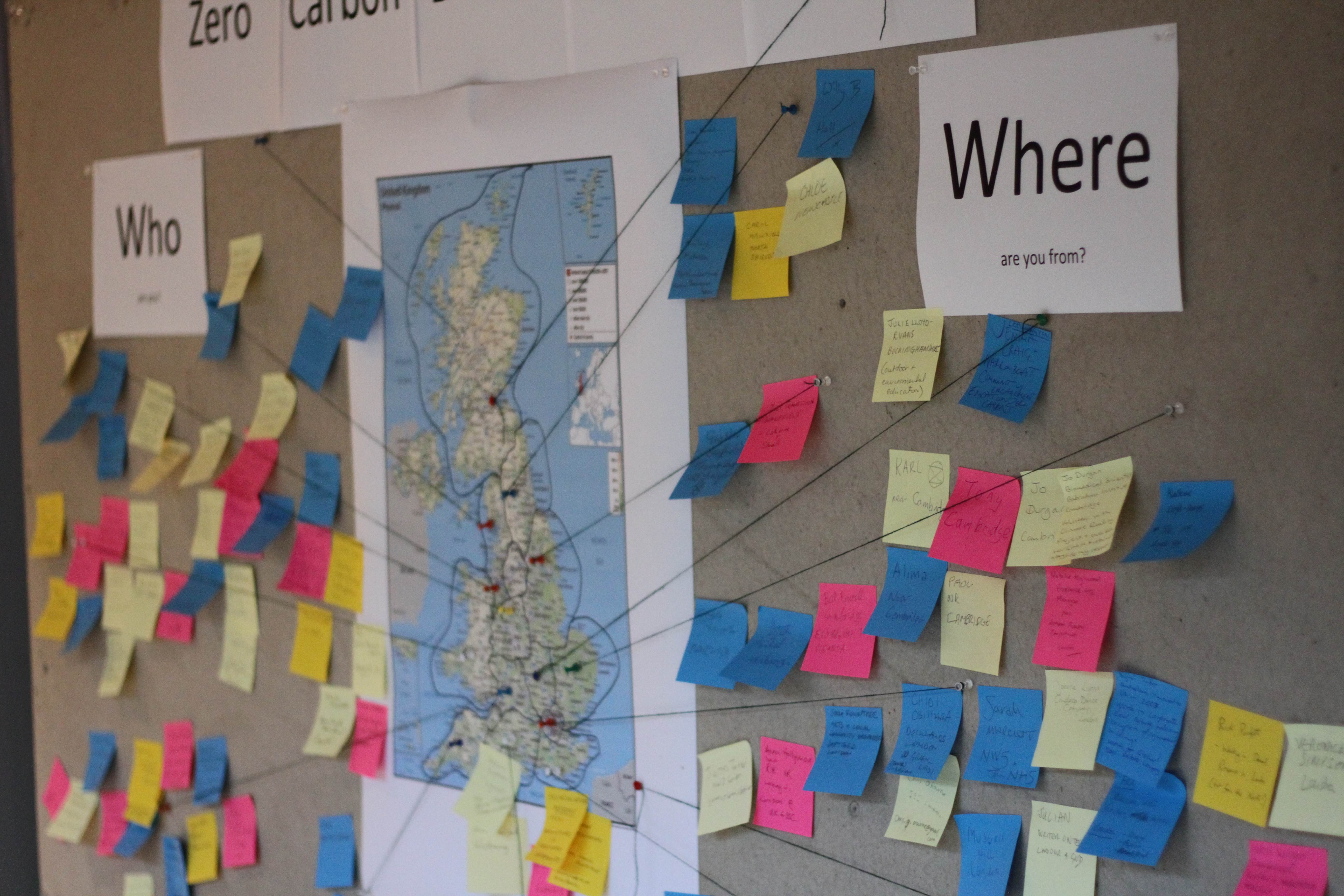wall covered in post it notes leading to a map of Britain, showing ideas about how to save carbon in the UK