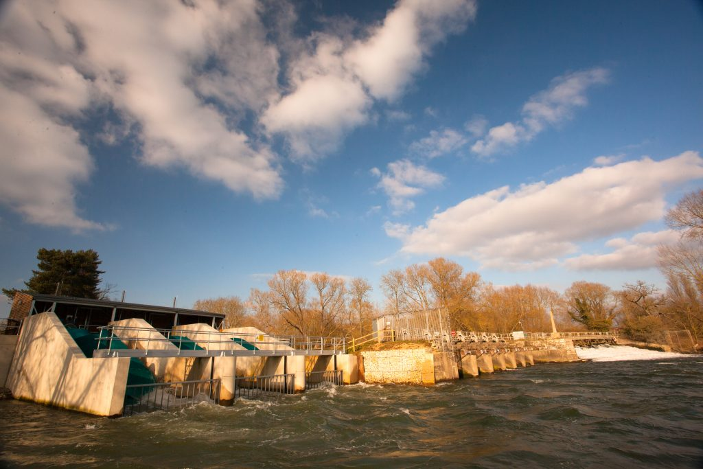 a hydro electric power barrier across a river, showing our commitment to renewable energy