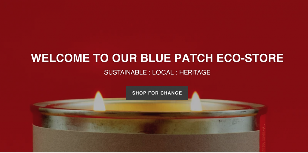 banner image from a website showing a candle lit, on a red background. The search bar for the Blue Patch eco-store