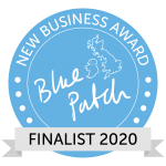 circular logo in blue with silver sash with the words new business award 2020 blue patch, finalist