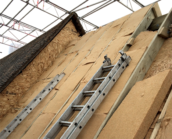 a sustainable, insulated roof under construction by retrofit specialists Borisa Ristic, helping fight climate change
