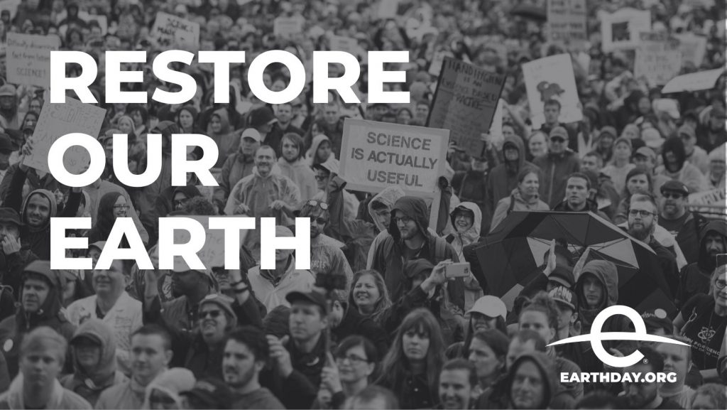 black and white image of climate change protesters with the words restore our earth, stop climate change and earth day 2021 logo