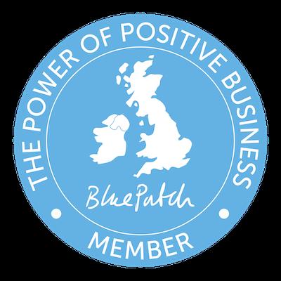 Positive Business blue circular logo, map of the UK and Ireland
